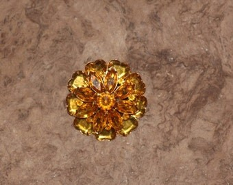 Vintage gold colored brooch