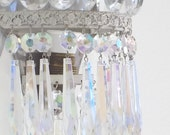 Reserved for L. Pair of French empire style sconces ivory color with Aurora borealis crystals and drops