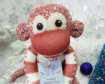 Crispin, the Red and White Striped Monkey with a Snowflake Sweater