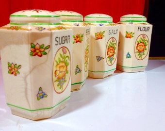SHAKERS Four Salt Pepper Flour Sugar Made in Japan White with green trim floral embellishments