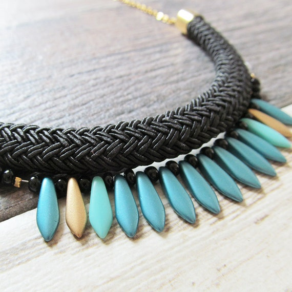 Ajustable necklace on stainless gold chain with turquoise, gold, beads and black seed bead on black braided polyester cord, les perles rares