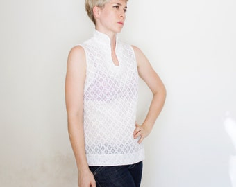Vintage 60's polyester sleeveless top, high neck, zips up the back, bright white, embroidered pattern, eyelet material - Medium