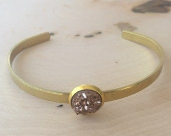 ONE sparkly bezel set cuff bracelet