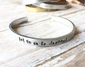 Let Go Or Be Dragged- Hand Stamped Cuff Mixed Metals Stacking layering bracelet bangle by Inspired Jewelry Designs