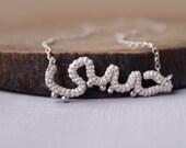 Habibi - Arabic Word Pendant Necklace - White Silver Metallic Crochet