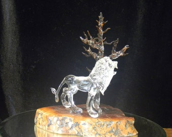 Glass lion with glass tree