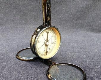 A bit of a Parisian... Vintage multifunction tool compass part.