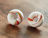 White studs, donuts shaped studs post earrings with white pink, orange and green accents