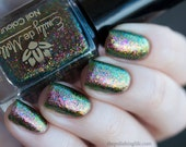 """Nail polish - """"Insipid"""" green to pink multichrome flakes in a clear base"""