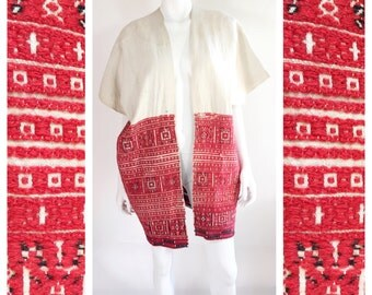 Vintage 1950s ceremonial Guatemalan Huipil coat vest with detailed red and black hand embroidery.