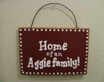 2710 Home of an Aggie family plaque