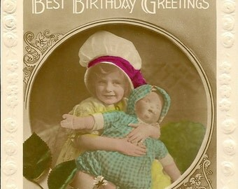 RPPC Young Girl With Her Baby Doll – Antique Birthday Postcard – Red Rose and Carnations