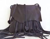 black leather handbag messenger with fringe, by Tuscada. Made to order.
