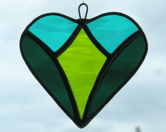 Abstract Stained Glass (Love Heart) in teal green, moss green and dark teal green rippling water glass