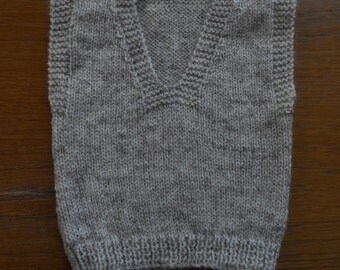 Vest/tank top/sweater, for a baby boy. Newborn size 0-3 months, chest approx 14-15 ins.  hand knitted in a fawn/beige mix yarn.