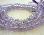 Tiny pale amethyst faceted round beads 2-3mm 1/2 strand