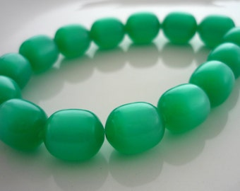 Vintage emerald green lucite moonglow oval beads 10mm x 9mm