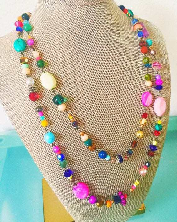 Colorful Double Strand Glass Beaded Necklace. A beautiful statement necklace of bright unique beads to add color and style to any outfit