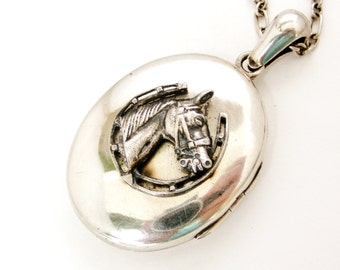 Antique sterling silver locket, horse and horseshoe design, on long silver chain.