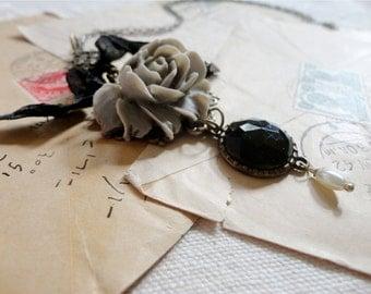 Large grey rose necklace with shiny jet black pendant, black crinkle ribbon, and bronze rhinestone accents, long necklace, Darkness & Dusk