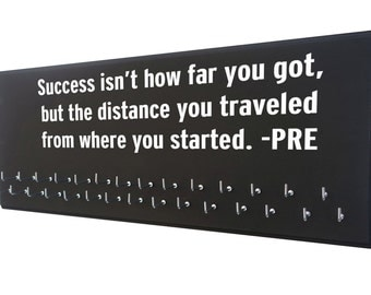 Running quotes, Running Medal display, Prefontaine, Success isn't how far you got, but the distance you traveled from where you started.