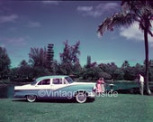 The new 1956 Ford at the Lilioukalani Gardens. Hilo, Hawaii. Color print from original negative. Mid-century auto history. Vintage Decor