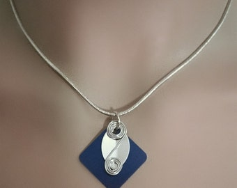 Handmade and lightweight necklace - silver and blue metallic handcut discs in different shapes - a double spiral - silver snake chain