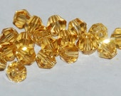 35 pcs 4mm Transparent Faceted Gold Bicone Crystals