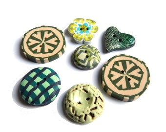 Polymer clay green buttons, set of 7 orphan green buttons, incl geometric cannes, green heart, green with patina, unique set with a flower