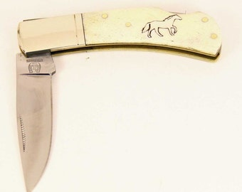 Rough Rider White bone pocket knife with Sterling Silver Horse inlay