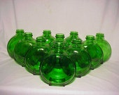 Group of Ten 1936-39 Emerald Green Glass Sunsweet Prune Juice bottles Great Wedding Decor No. 1
