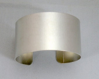 1 inch wide by six inches long, one dozen (12) Aluminum Cuff Bracelet Blanks