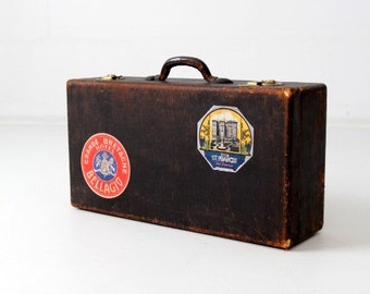 vintage suitcase with travel stickers, black leather luggage