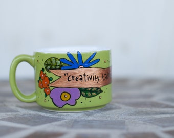 "Henri Matisse ""Creativity takes courage"" Hand painted literary quote mug - Small, lime green cup with banners and flowers"