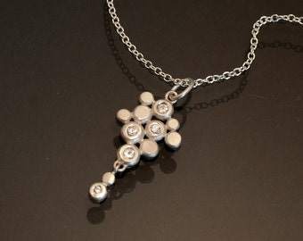 White sapphire and sterling silver pendant