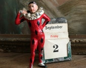 Hey Look At Me I'm A Jester And An Antique Perpetual Calendar