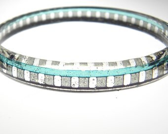 resin and filmstrip spacer bracelet . Super 8 size sprocket edge . vintage turquoise blue gray and black film edge