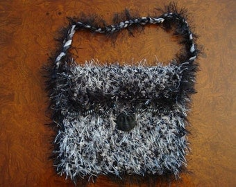 Crochet Black and White Furry Lined Purse with Black hand-made Face Pendant