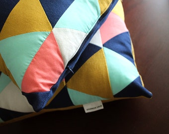 Quilted Triangle Pillow in Navy, Goldenrod, Salmon, and Pale Aqua