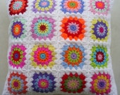 a hippie happy crochet granny square cushion cover / pillow cover in white edging
