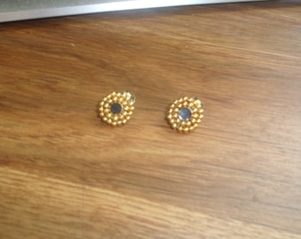 vintage clip on earrings goldtone black glass
