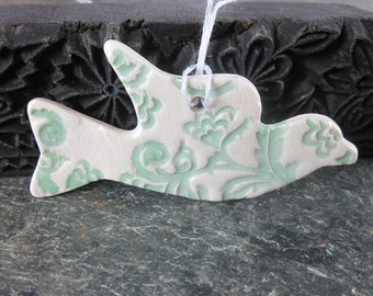Green and White Stoneware Flying Dove Ornament