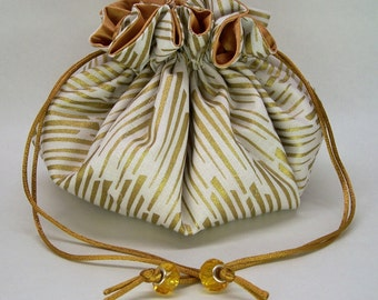 Gold and White Jewelry Pouch
