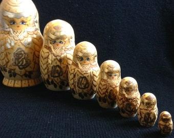 7 Wood Russian Nesting Dolls.   Matryoshka.  Signed Cepzueb Nocad.  Gold Floral.  Vintage Modernist. Mod, Mid century.