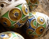 Enamel Moroccan medium tarnished  focal bead  with blue ends
