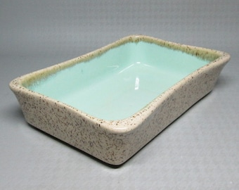 GLIDDEN pottery low rectangular bowl , speckle glaze exterior turquoise interior , numbered 1008