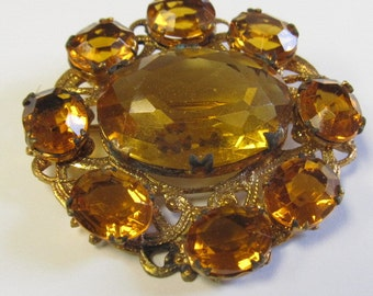 Vintage Oval Shaped Brooch with Amber/ Topaz Glass