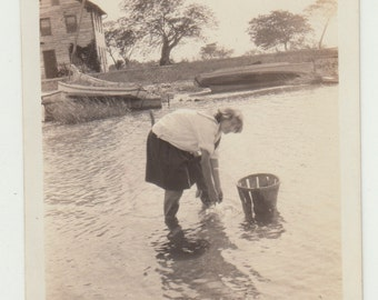 Vintage/ Antique Photo of a woman washing her hand in a lake