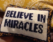 Needlepoint front pillow miracles quote navy velvet back