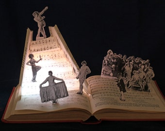 Nine Ladies Dancing greeting card from a Twelve days of Christmas altered book sculpture